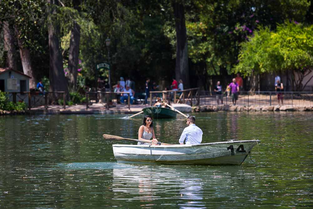 Taking a row boat for a ride in the Villa Borghese small lake