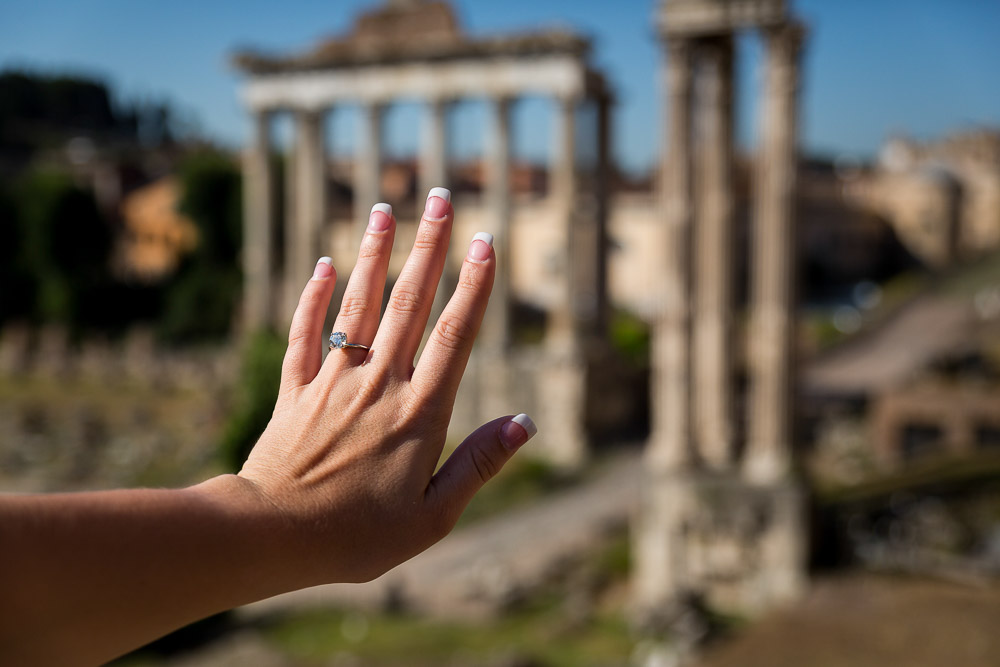 Engagement ring picture over ancient temple columns found in the Roman Forum
