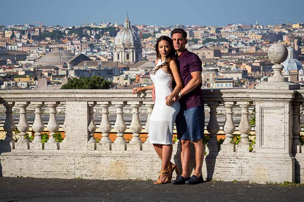 Couple posing for engagement pictures in Rome by the Janiculum hill
