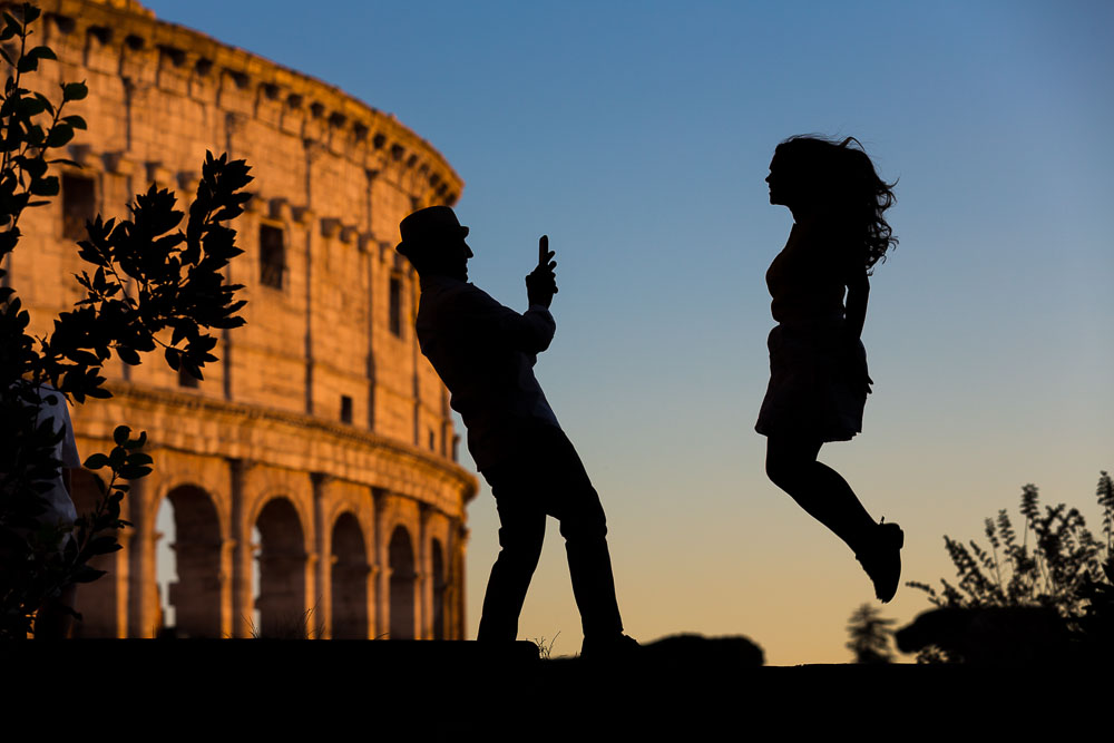 Jumping up in the air during an engagement photo session in Rome Italy
