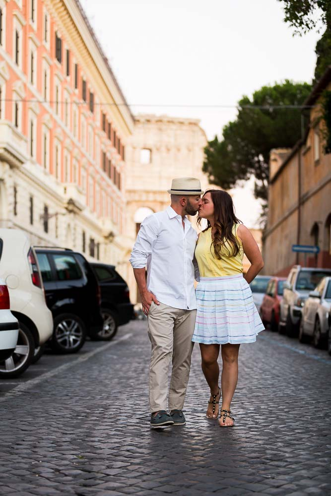 Walking in the roman alleyways with the Colosseum in the background during an e-session