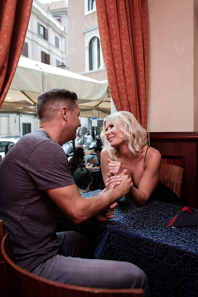Romance inside an Italian cafe bar during and engagement session indoor