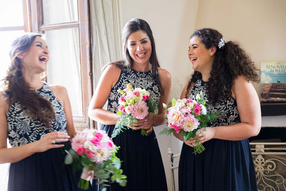Bridesmaids laughing on the wedding day