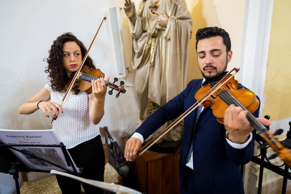 Matrimonial music being played. Violins