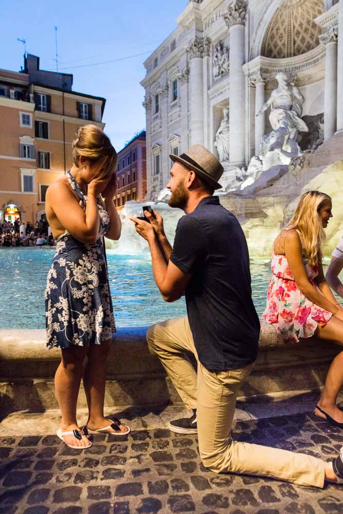 Knee down nighttime wedding proposal in Rome