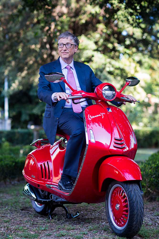 Bill Gates on Red Vespa