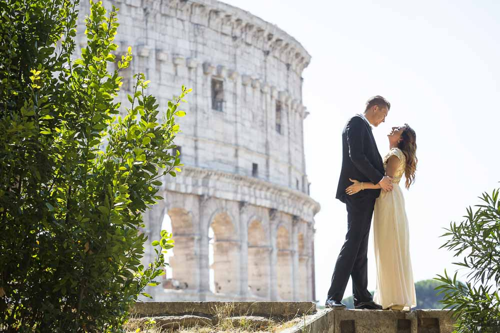 Wedding newlywed couple at the Roman Colosseum on a Rome destination photo shoot