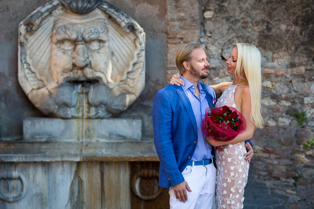 Couple portrait at a marble fountain in Rome