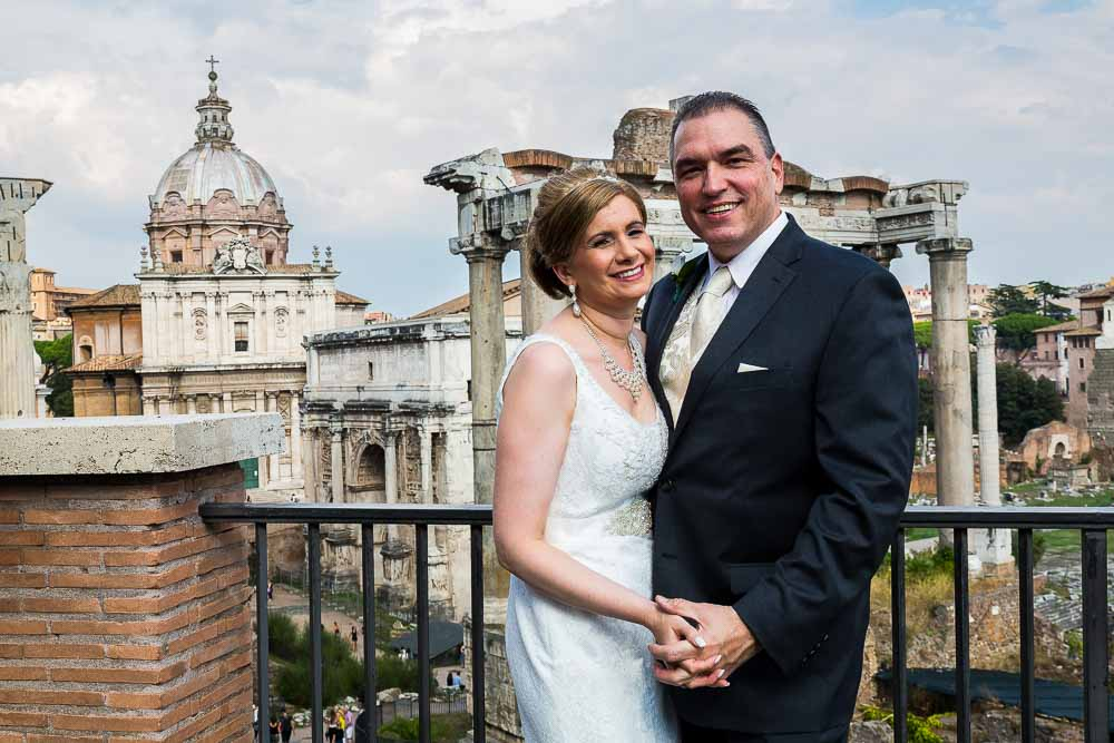 Wedding couple posing in front of the Roman Forum
