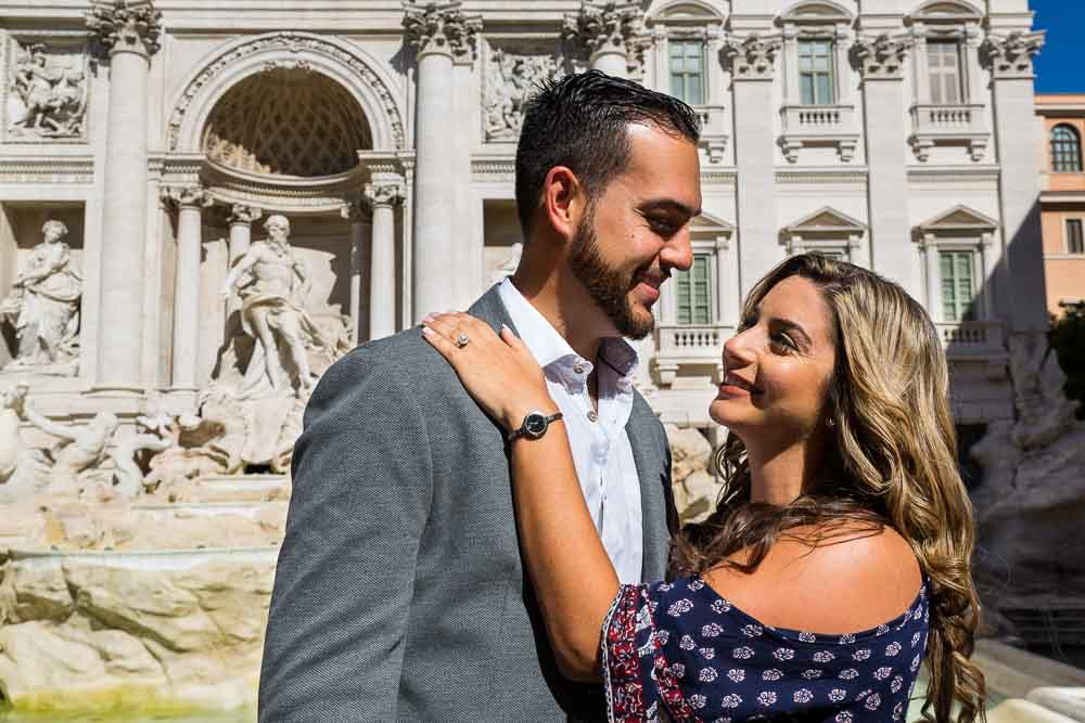 Couple together during a photo shoot in front of the Trevi fountain