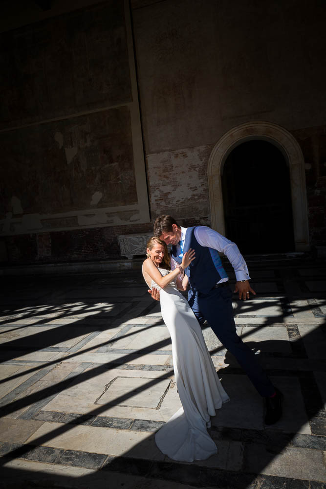 Picture of a just married couple in between light and shadow