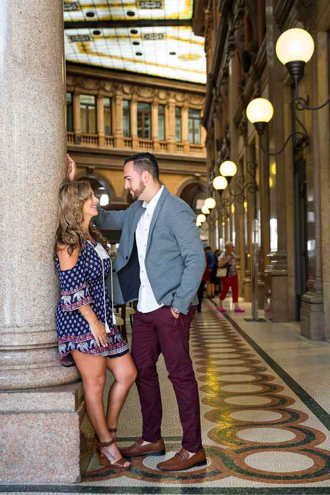 Couple just engaged posing inside the Galleria Alberto Sordi gallery