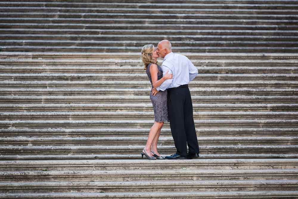 Couple kissing on the campidoglio staircase