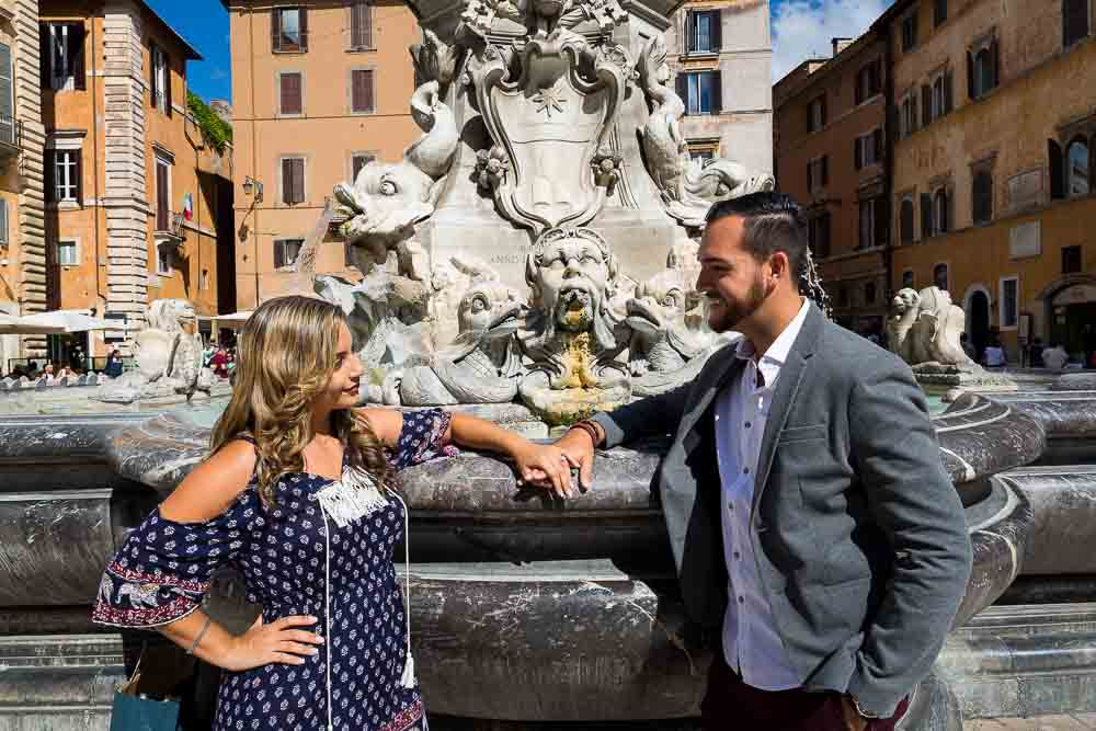 Hand in hand in piazza della rotonda during an engagement photography session