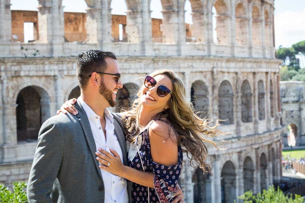 Fun at the Colosseum during an engagement photography session in Rome