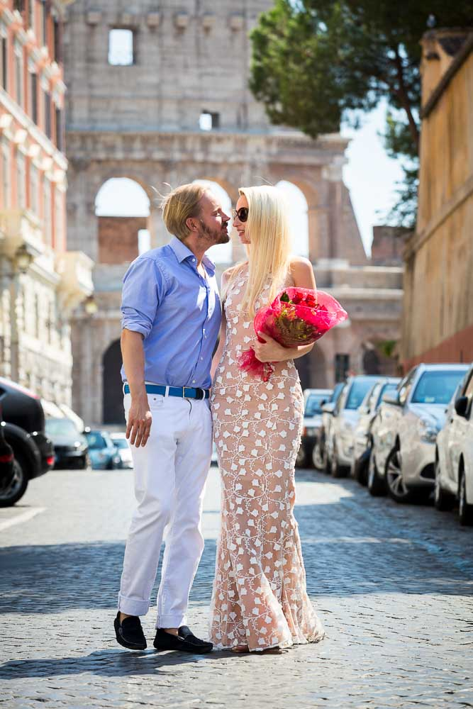 Romantic stroll in a typical roman street by the Rome Colosseum