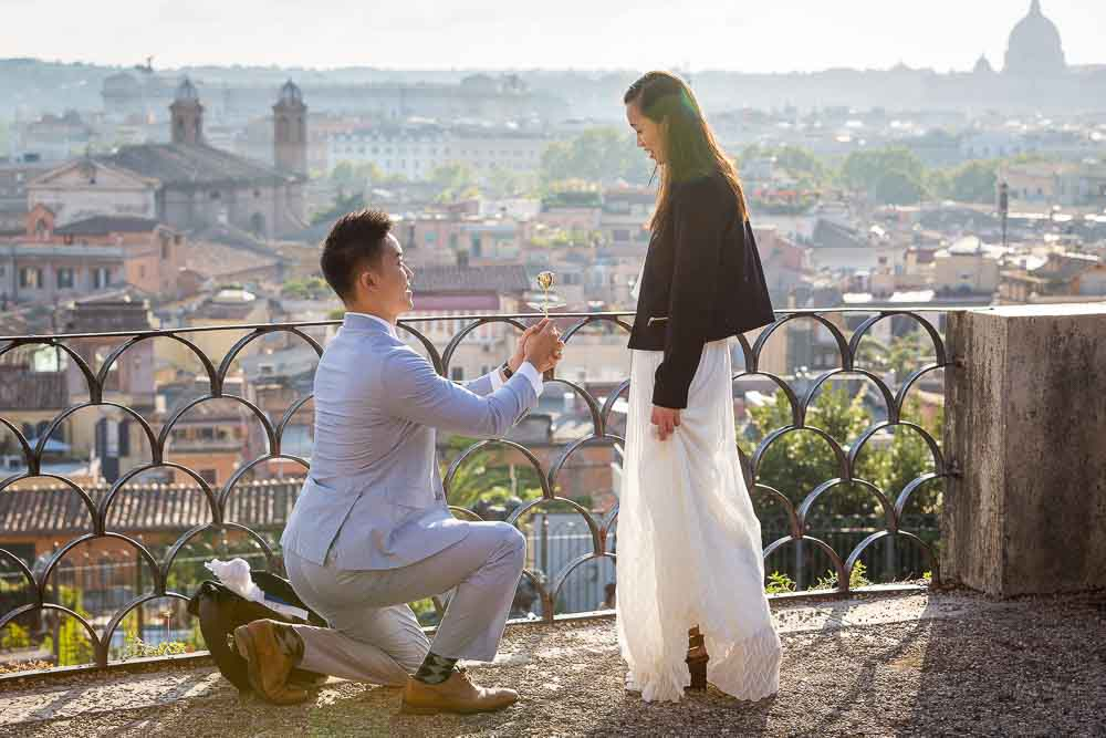 Wedding marriage proposal photographed at sunset overlooking the panoramic city of Rome from above