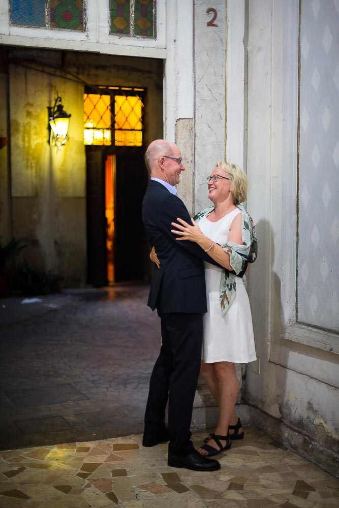 Couple together inside a typical Italian building