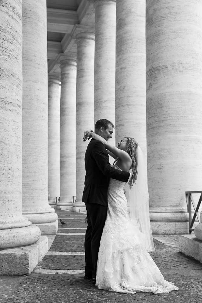 Bride and groom together under the Saint Peter's colonnade