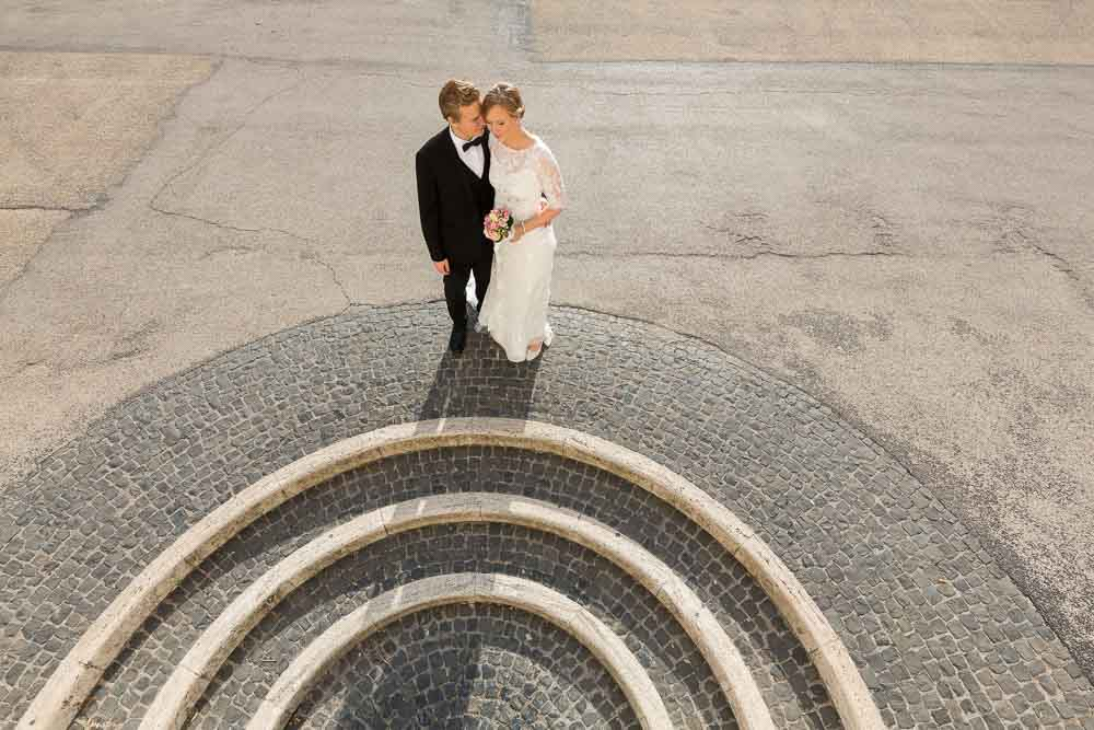 Bride & Groom posing during a newlywed photo shoot. Roman circular staircase.