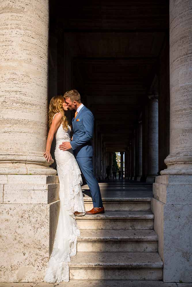 Newlyweds leaning against an ancient marble column