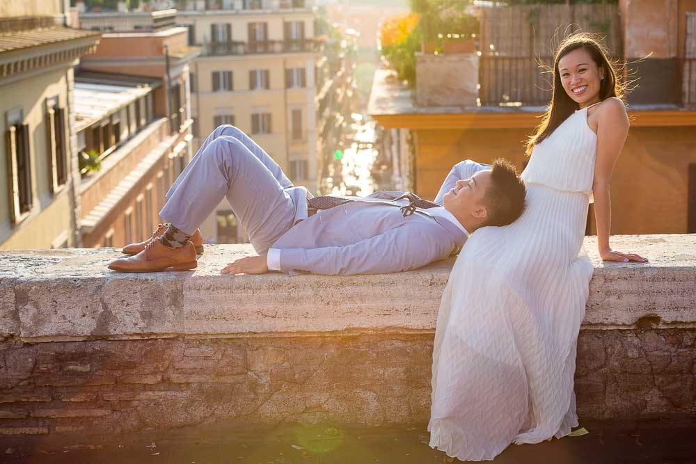 Couple wedding engagement session in Rome Italy overlooking the rooftops at sunset
