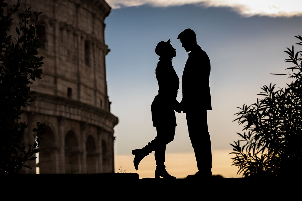 Silhouette image at the Roman Colosseum. Engagement photos in Rome, Italy.