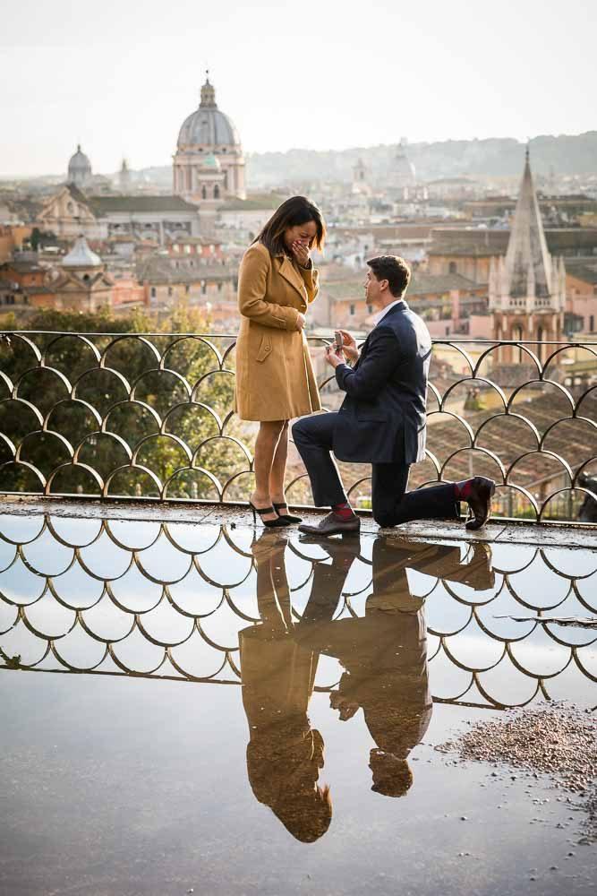 Knee down wedding marriage proposal overlooking the roman skyline