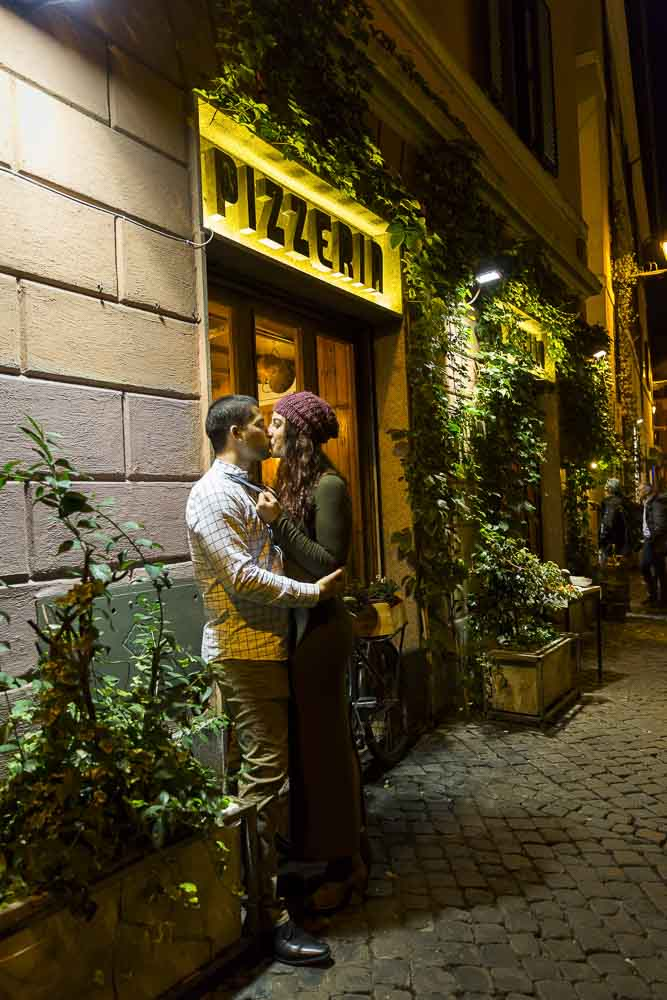 Romantic imagery of a man and woman together in the streets of Rome