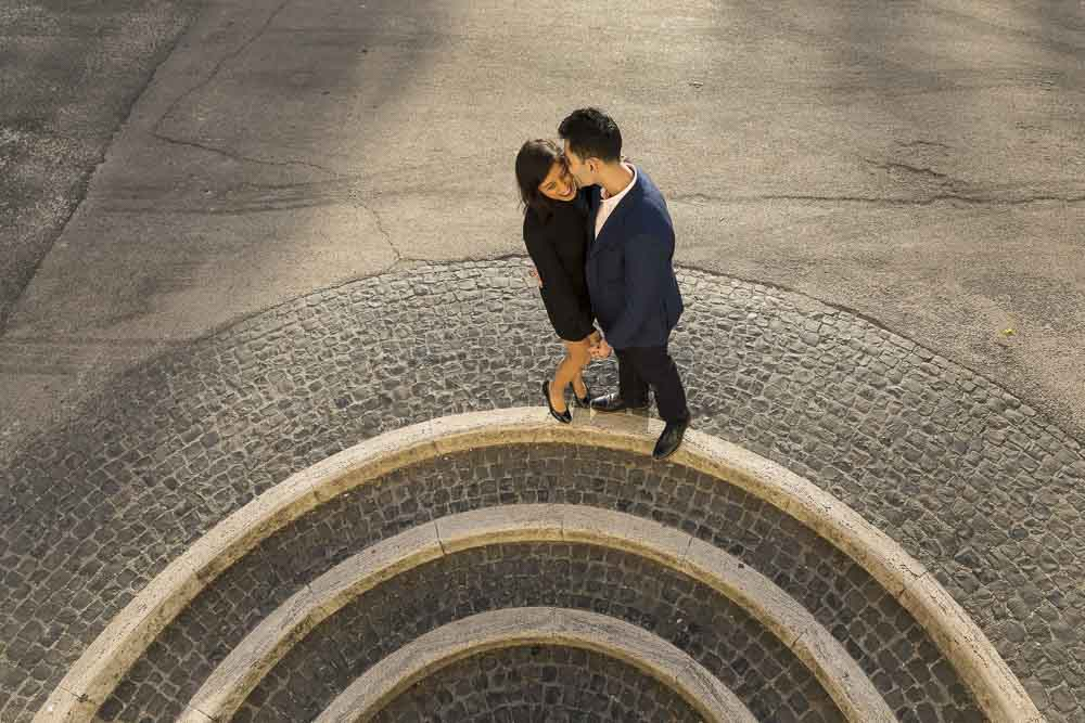 Engagement photography by circular staircases