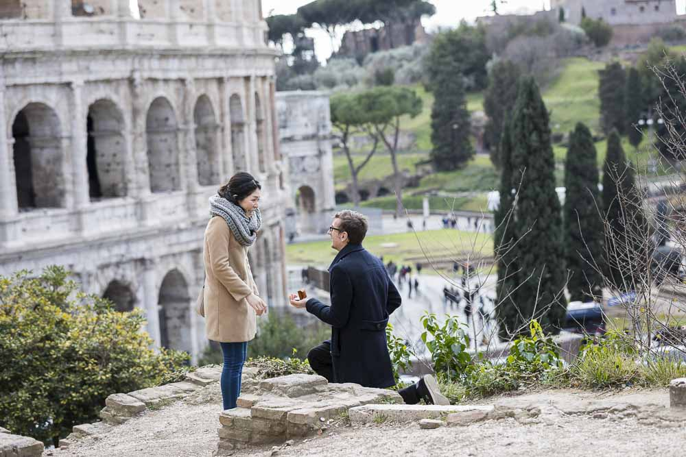 Candid surprise wedding marriage proposal photo shooting at the Roman Colosseum in Rome Italy