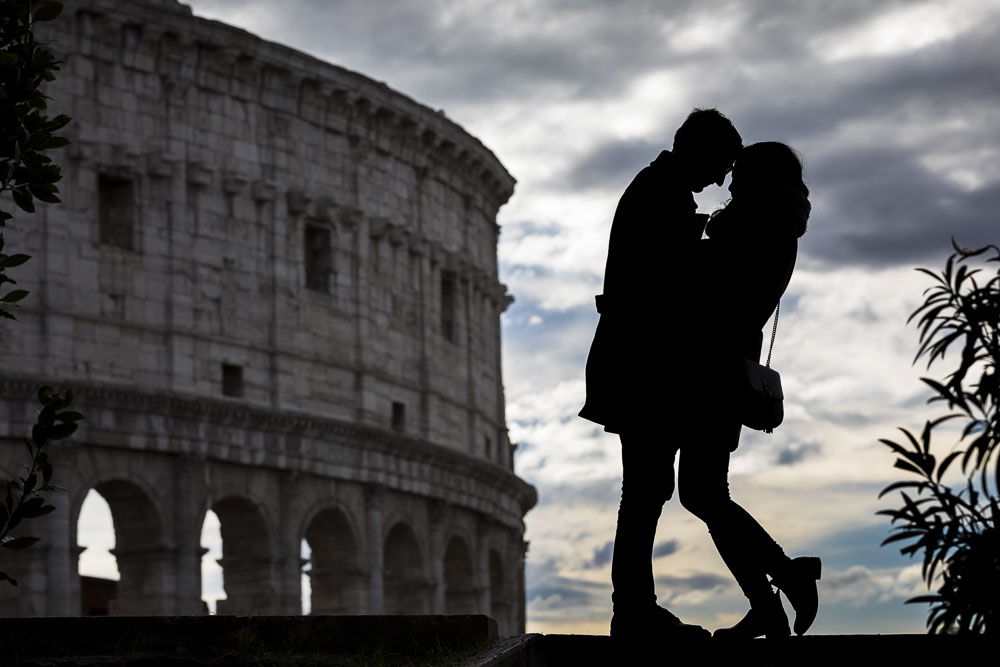 Silhouette creative engagement imagery. Picture taken at the Coliseum in Roma at sunset