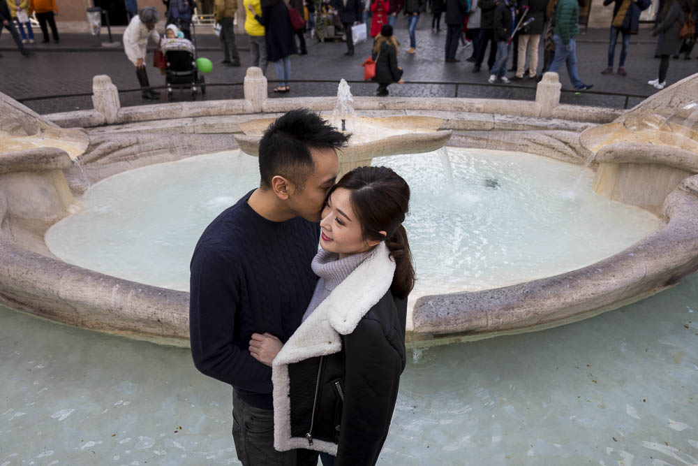 Engaged and in love by the Barcaccia water fountain at the bottom of the Spanish steps