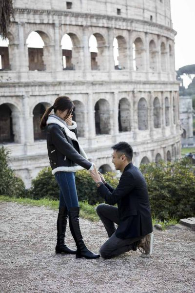 Sitting down wedding marriage proposal at the Roman Colosseum