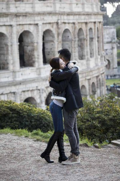 In love in Italy by the Coliseum