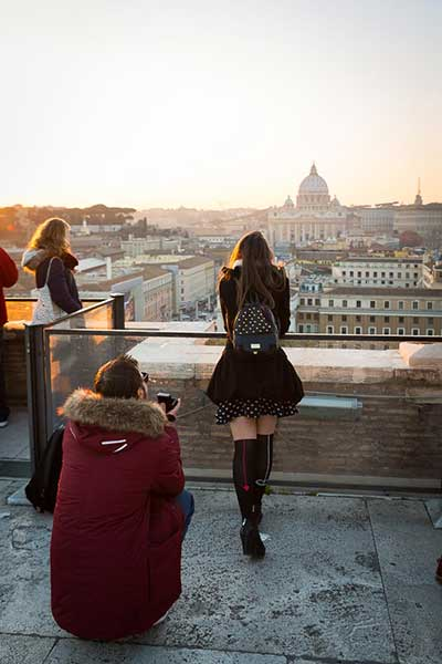 Man proposing on top of the Castel Sant'Angelo bridge in Rome Italy