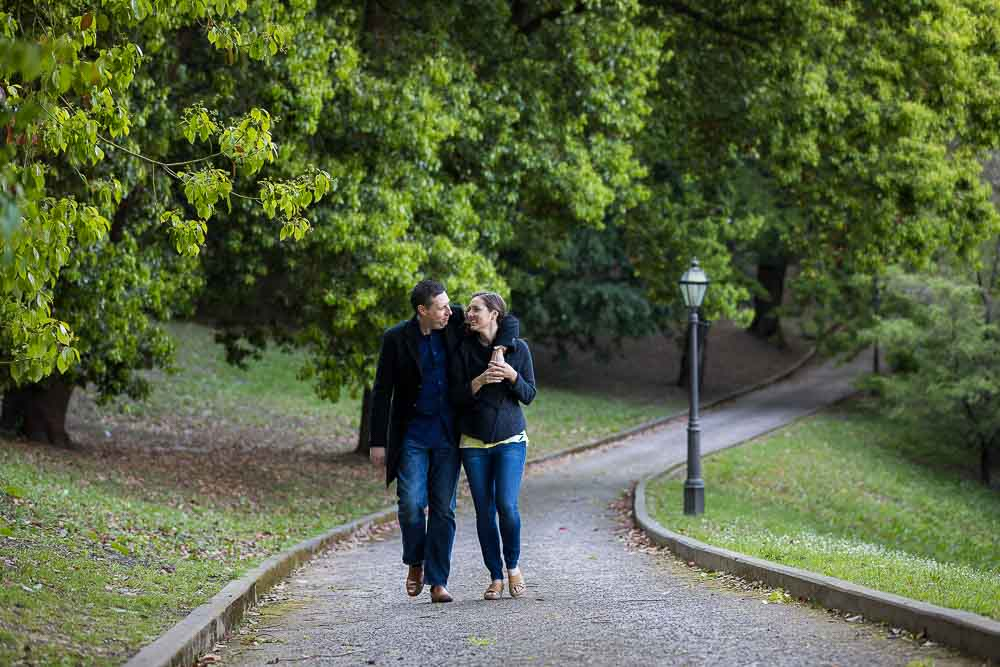 Couple walking forward in a park