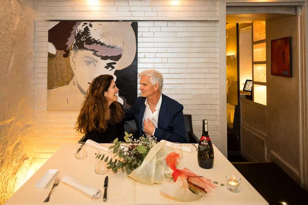 Restaurant interior couple having romantic dinner