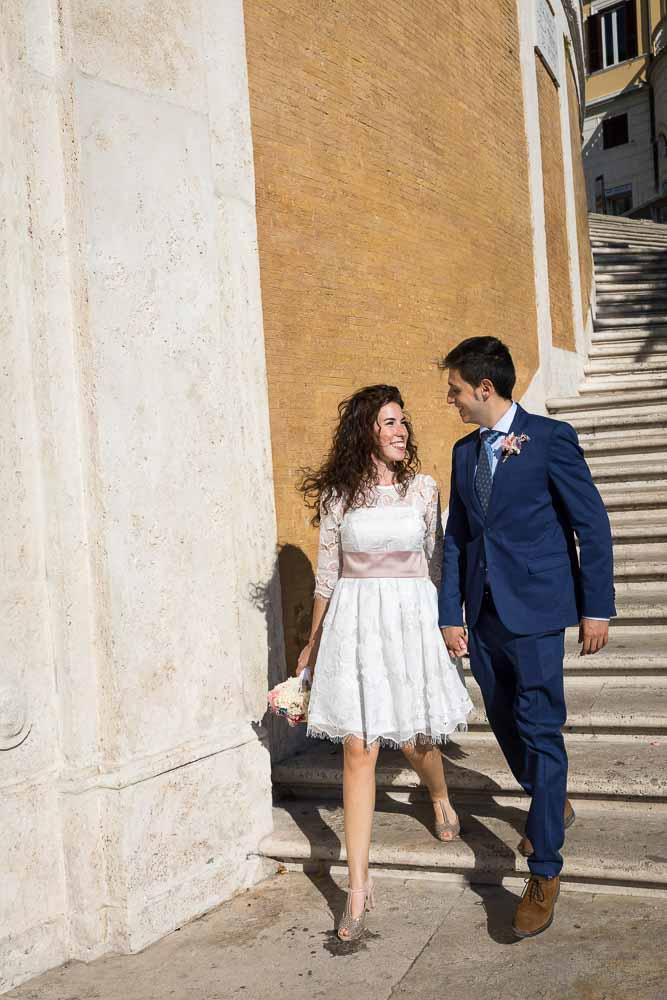 Newlywed descending stairs together