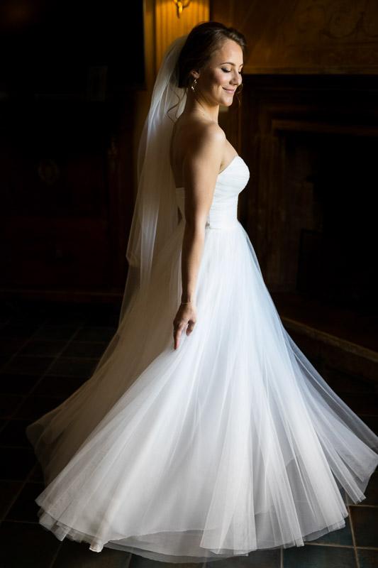 Wedding dress spinning around by the window