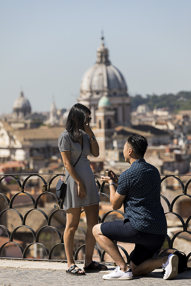 Wedding marriage proposal at Parco del Pincio with the beautiful roman rooftops in the background