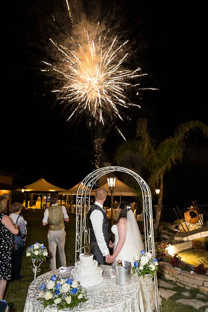 Bride and groom fireworks in the sky