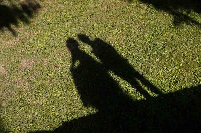 Wedding couple shadows while kissing