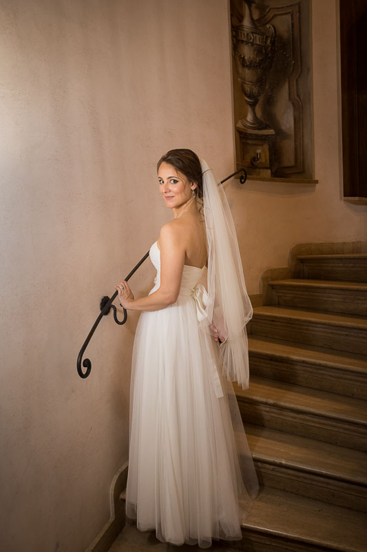 Bridal posing for a portrait on the stairs