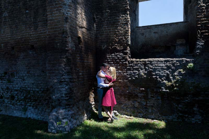 Light and shadow image of a couple by ancient roman walls
