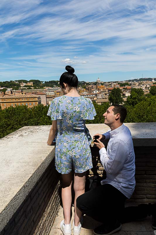 Surprise Proposal with Hidden Photographer overlooking the roman cityscape