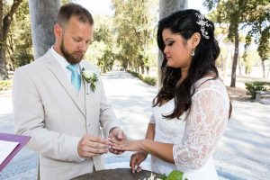 Bride and Groom exchanging nuptial rings