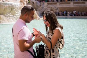 Couple looking at the engagement ring after the proposal