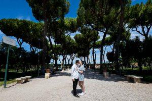Posed underneath Mediterranean pine trees