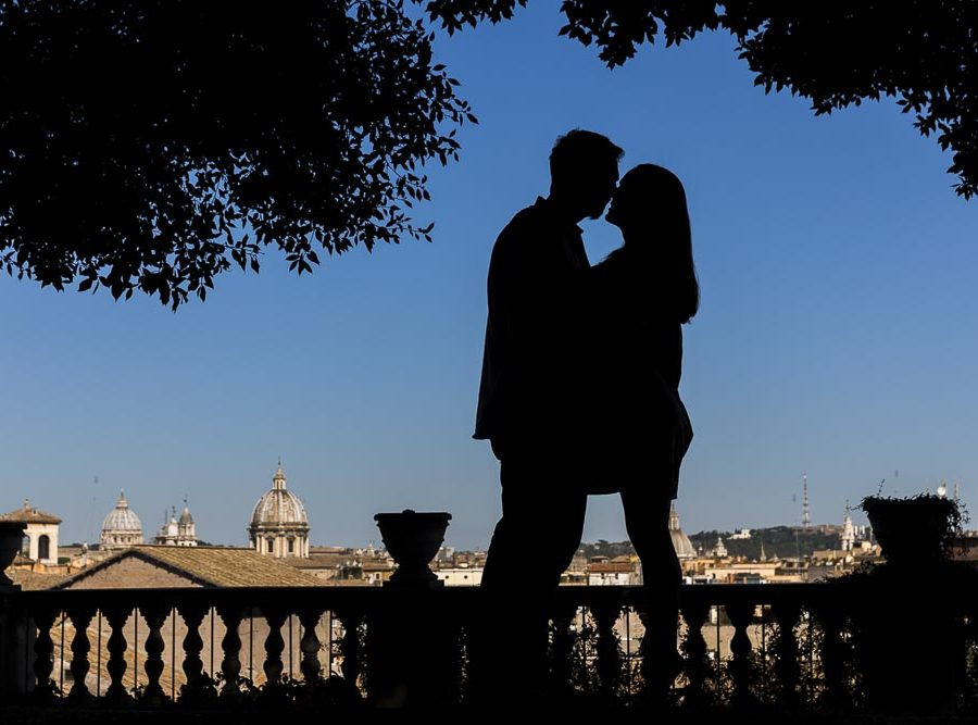 Silhouette image of couple photographed over the roman skyline
